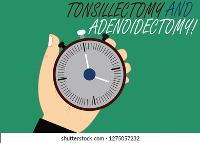 Word writing text Tonsillectomy And Adenoidectomy. Business concept for Procedure in removing tonsil and adenoid Hu analysis Hand Holding Mechanical Stop Watch Timer with Start Stop Button.