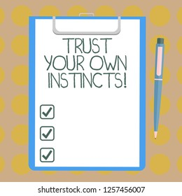 Word writing text Trust Your Own Instincts. Business concept for Intuitive follow demonstratingal feelings confidence Blank Sheet of Bond Paper on Clipboard with Click Ballpoint Pen Text Space.