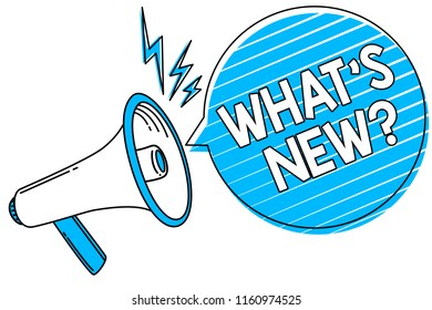 Word writing text What s is New question. Business concept for Asking about latest Updates Trends Happening News Megaphone loudspeaker blue speech bubble stripes important loud message.