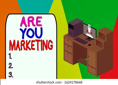 Word writing text Are You Marketing. Business concept for Actions to promote brand product Sales in market Working desktop station drawers personal computer launching rocket clouds.