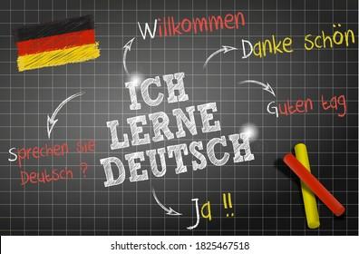 """words and draws of the deutsch theme """"Ich lerne deutsch"""" means I learn Deutsch on chalkboard"""