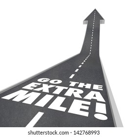 The words or saying Go the Extra Mile on a road with arrow going upward to illustrate improvement, increase and additional effort to accomplish a goal or mission
