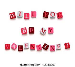 """Words """"will you be my valentine?"""" with colorful blocks isolated on a white background. Description with bright cubes. Valentine's day card."""