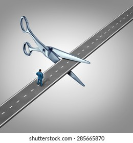 Work interruption concept and interrupted career path as a businessman on a road  that is being cut by scissors as a layoff metaphor and symbol for job and employment limits or cutting benefits.