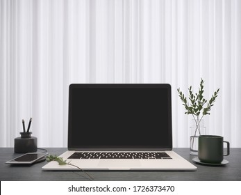 Working room.Workspace with laptop.Smart phone charging,vase,coffee cup on wooden desk and white curtain.3d rendering