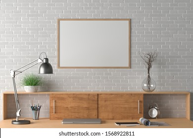 Workspace with horizontal poster mock up on the white brick wall. Desk with drawers in interior of the studio or at home. Clipping path around poster. 3d illustration.