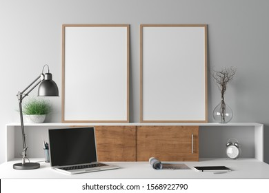 Workspace with two vertical poster mock ups on the desk. Desk with drawers in interior of the studio or at home with white wall. Clipping path around poster. 3d illustration.