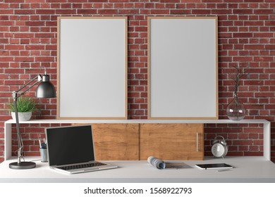 Workspace with two vertical posters mock up on the desk. Desk with drawers in interior of the studio or at home with red brick wall. Clipping path around poster. 3d illustration.