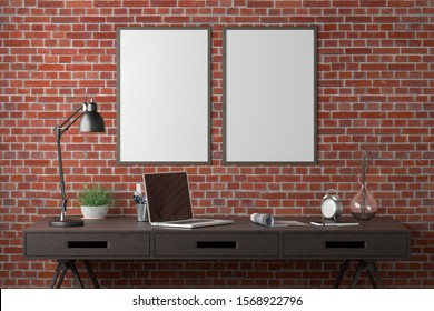 Workspace with two vertical posters mock up on red brick wall. Desk with drawers in interior of the studio or at home. Clipping path around poster. 3d illustration.