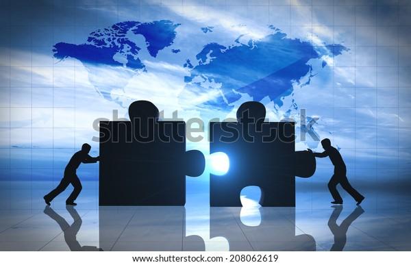World Business teamwork puzzle pieces.