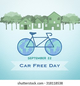 World Car free day on September 22 campaign with drawing of bicycle with world map wheels and clean environment of town on recycled paper background