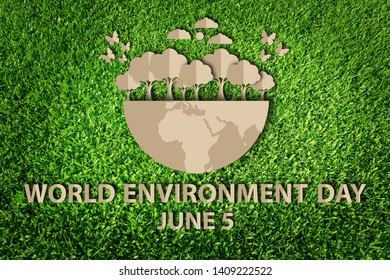 World environment day concept. Paper cut of eco on green grass.