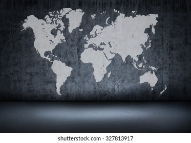 World map on old wall in a dark room.
