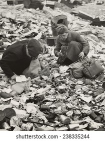 World War II, two Germans searching for food in a garbage dump,'Hunger, the price of defeat', Berlin, Germany, photograph by Emil Reynolds, 1945.
