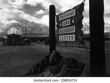 World War II, Wooden sign at entrance to the Manzanar War Relocation Center, California. photograph by Ansel Adams. 1943