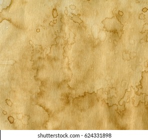worn paper with coffee stains. Background with room for text or images.