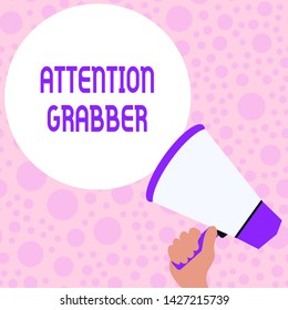 Writing note showing Attention Grabber. Business photo showcasing Deanalysisding notice mainly by being prominent or outlandish Hand Holding Loudhailer Speech Text Balloon Announcement New.