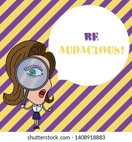 Writing note showing Be Audacious. Business photo showcasing Takes risks in order to achieve something Unconventional Daring Woman Looking Trough Magnifying Glass Big Eye Blank Round Speech Bubble.