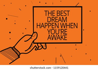 Writing note showing The Best Dream Happen When You re are Awake. Business photo showcasing Dreams come true Have to believe Man hand holding paper communicating information dot orange background.