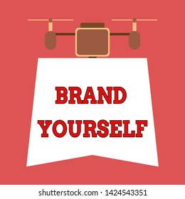 Writing note showing Brand Yourself. Business photo showcasing Develop a unique professional identity Personal product Drone holding downwards banner. Geometrical abstract background design.