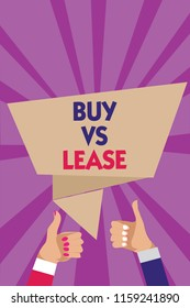 Writing note showing Buy Vs Lease.  Man woman hands thumbs up approval speech bubble rays background.