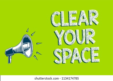 Writing note showing Clear Your Space. Business photo showcasing Clean office studio area Make it empty Refresh Reorganize Artwork convey message speaker alarm announcement green background.