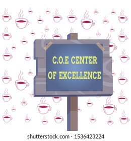 Writing note showing Coe Center Of Excellence. Business photo showcasing being alpha leader in your position Achieve Wood plank wood stick pole paper note attached adhesive tape.