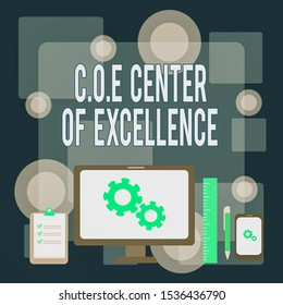 Writing note showing Coe Center Of Excellence. Business photo showcasing being alpha leader in your position Achieve Business Concept PC Monitor Mobile Device Clipboard Ruler Ballpoint Pen.