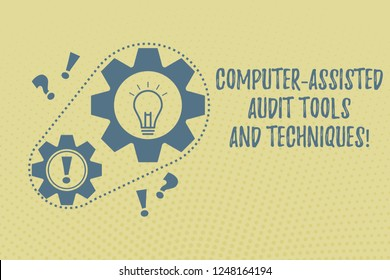 Writing note showing Computer Assisted Audit Tools And Techniques. Business photo showcasing Modern auditing applications Chain Surrounding Big and Small Gears with Bulb Punctuation Mark icon.