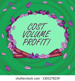 Writing note showing Cost Volume Profit. Business photo showcasing form of cost accounting and It is simplified model Wreath Made of Different Color Seeds Leaves and Rolled Cinnamon photo.
