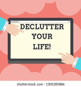 Writing note showing Declutter Your Life. Business photo showcasing remove unnecessary items from untidy overcrowded place Hu analysis Hands Pointing on a Blank Color Tablet Screen.