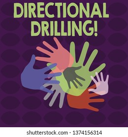 Writing note showing Directional Drilling. Business photo showcasing drilling for oil which the well not drilled vertically Hand Marks of Different Sizes for Teamwork and Creativity.