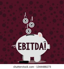Writing note showing Ebitda. Business photo showcasing Earnings Before Interest Taxes Depreciation Amortization Abbreviation Piggy Bank Sideview and Dollar Coins Falling Down to Slit.