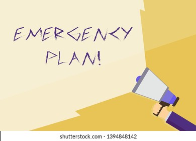 Writing note showing Emergency Plan. Business photo showcasing actions developed to mitigate damage of potential events Hand Holding Megaphone with Beam Extending the Volume Range.