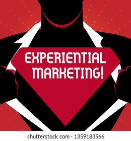 Writing note showing Experiential Marketing. Business photo showcasing marketing strategy that directly engages consumers Man Opening his Shirt to reveal the Blank Triangular Logo.