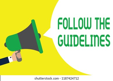 Writing note showing Follow The Guidelines. Business photo showcasing Manual of Style Follow a Specified Rule Accordingly Man holding megaphone loudspeaker speech bubble message speaking loud.