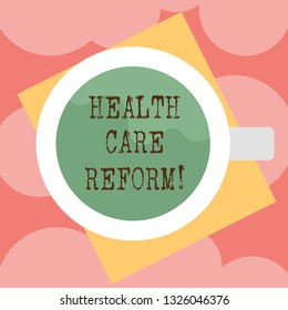 Writing note showing Health Care Reform. Business photo showcasing general rubric used for discussing major Medical policy Top View of Drinking Cup Filled with Beverage on Color Paper photo.