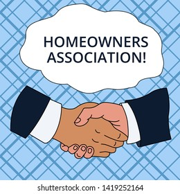 Writing note showing Homeowners Association. Business photo showcasing Organization with fee for upkeeps of Gated Community Hand Shake Multiracial Male Colleagues Formal Shirt Suit.