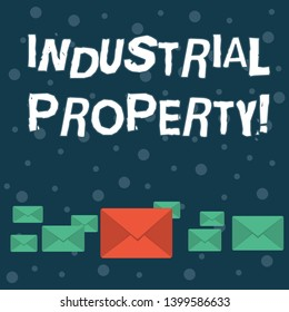 Writing note showing Industrial Property. Business photo showcasing the intangible ownership of a trademark or patent Color Envelopes in Different Sizes with Big one in Middle.