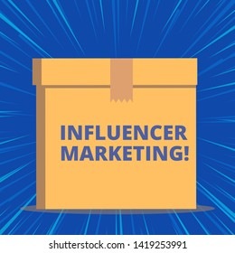 Writing note showing Influencer Marketing. Business photo showcasing Endorser who Influence Potential Target Customers Close up front view brown cardboard sealed box lid. Blank background.