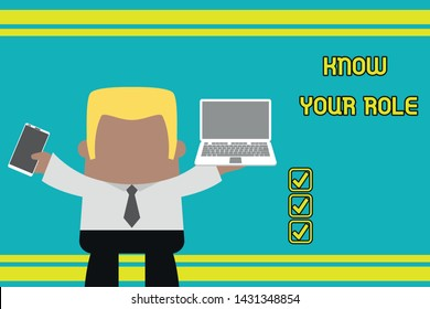 Writing note showing Know Your Role. Business photo showcasing end acting outside who you actually are Play your position Professional man holding laptop in left mobile phone right.