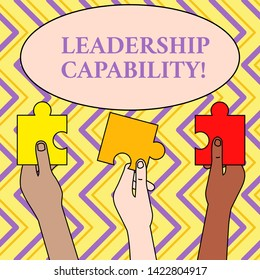 Writing note showing Leadership Capability. Business photo showcasing what a Leader can build Capacity to Lead Effectively Three Colored Empty Jigsaw Puzzle Pieces Held in Different People Hands.
