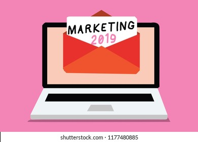 Writing note showing Marketing 2019. Business photo showcasing Commercial trends for 2019 New Year promotional event Computer receiving email important message envelope with paper virtual.
