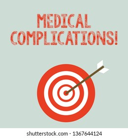 Writing note showing Medical Complications. Business photo showcasing unfavorable evolution or consequence of a disease Dart Board in Concentric Style with Arrow Hitting the Center Bulls Eye.