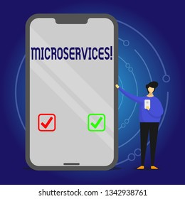 Writing note showing Microservices. Business photo showcasing Software development technique Decomposing an application Man Presenting Huge Smartphone while Holding Another Mobile.