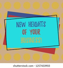 Writing note showing New Heights Of Your Business. Business photo showcasing Achieving goals fast growing up company Pile of Blank Rectangular Outlined Different Color Construction Paper.