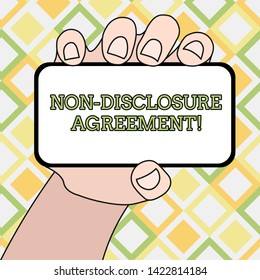 Writing note showing Non Disclosure Agreement. Business photo showcasing Legal Contract Confidential Material or Information Closeup of Smartphone in Hand with Blank Screen and Text Space.