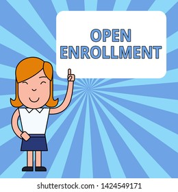 Writing note showing Open Enrollment. Business photo showcasing The yearly period when showing can enroll an insurance Woman Standing with Raised Left Index Finger Pointing at Blank Text Box.