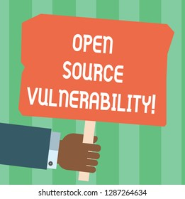 Writing note showing Open Source Vulnerability. Business photo showcasing Publicized Exploits are open to malicious users Hu analysis Hand Holding Colored Placard with Stick Text Space.
