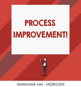 Writing note showing Process Improvement. Business photo showcasing Optimization Meet New Quotas Standard of Quality Isolated view man standing pointing upwards two hands big rectangle.